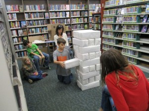 Kids play a giant-sized version of Jenga at Mentor Public Library's Headlands Branch.