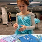 Sadie makes her own Christmas ornament at Mentor Public Library.