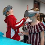 Claire and Maggie get a little disoriented while taking a virtual-reality tour of Tutankhamun's tomb.