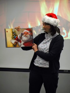 """Ms. Lisa reads """"Twas the Night Before Christmas"""" in front of our fireplace."""