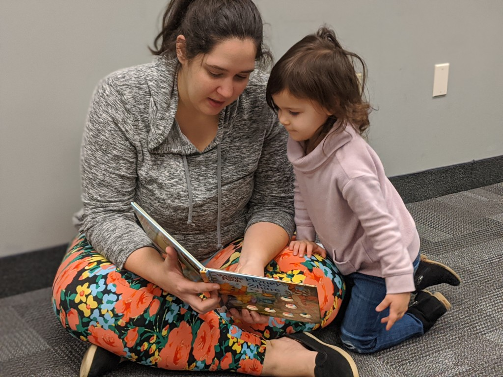 Families read together during the Winnie-the-Pooh party at Mentor Public Library.