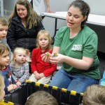 Jess shows the kids some chicks that hatched on Monday.