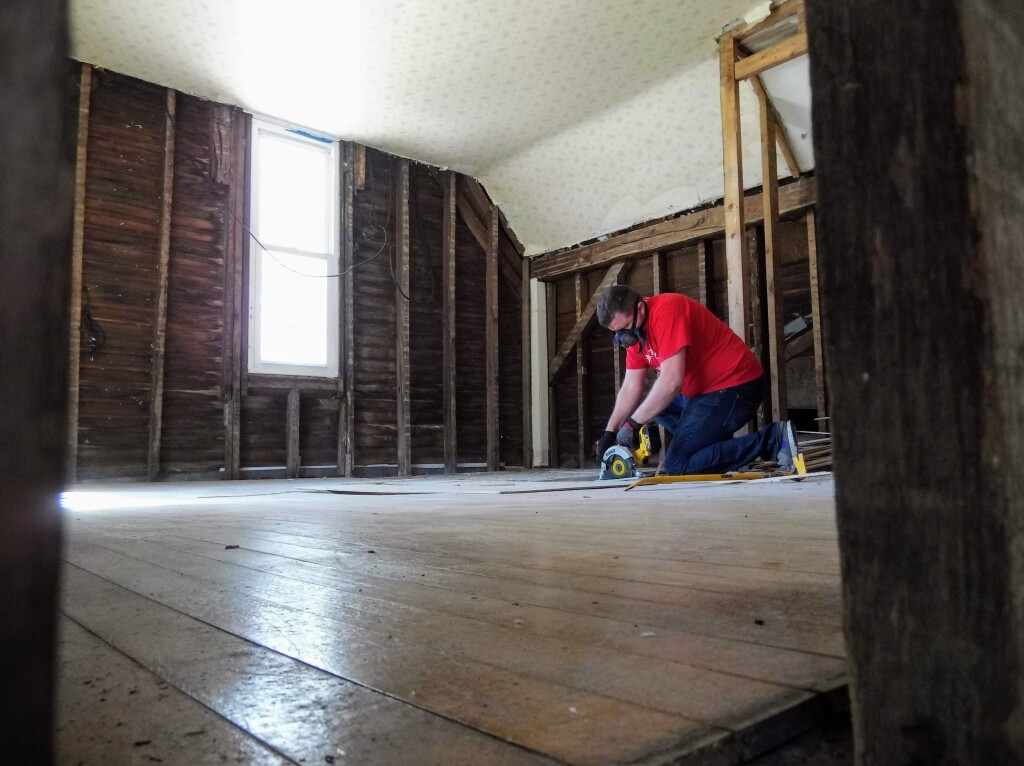 Corey of Cardinal Woodworking reclaims the poplar flooring that will be used to make unique furniture that honors the history of the Read House building