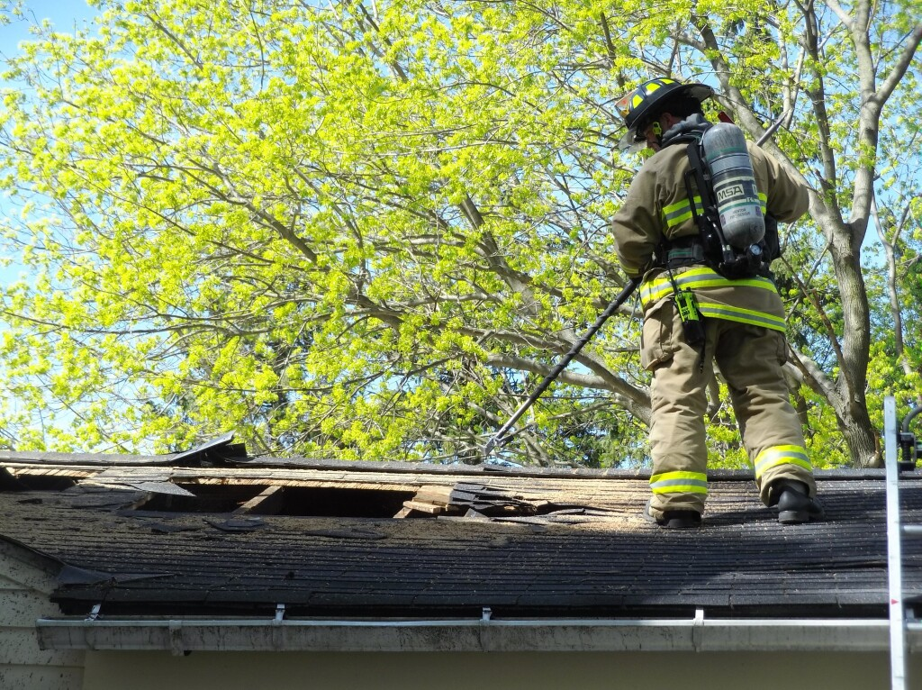 A firefighter from Mentor Fire Department practices vertical ventilation training.