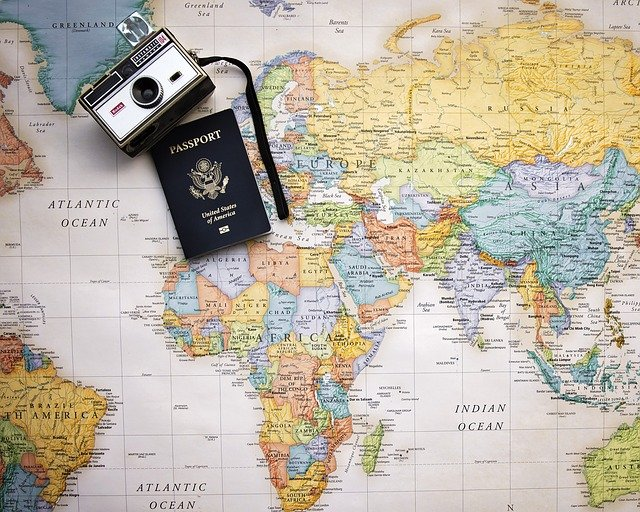 Passport and camera on a world map