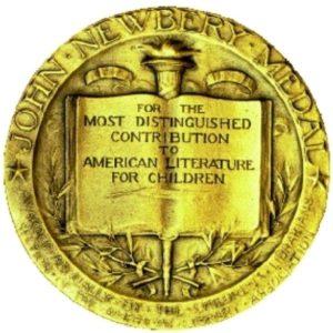 """A golden medal reading """"John Newbery Medal"""""""